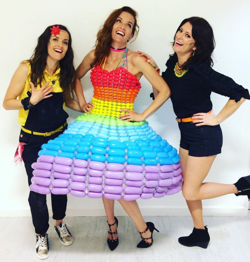 Stars of girl group Bewitched in Hull Pride balloon dress